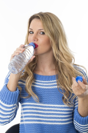 Model Released. Attractive Young Woman Drinking Water photo