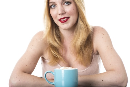 Model Released. Attractive Young Woman Drinking Coffee Stock Photo - 21898250