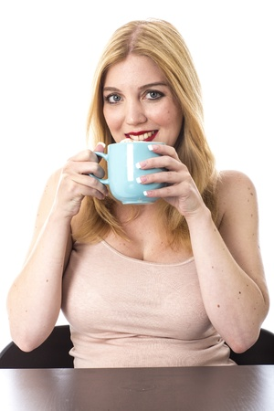 Model Released. Attractive Young Woman Drinking Coffee Stock Photo - 21898255