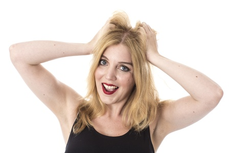 model released: Model Released. Excited Young Woman Pulling Hair Stock Photo