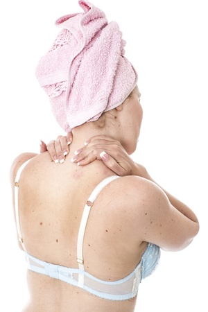 bathtowel: Model Released.  Young Woman with a Stiff Neck