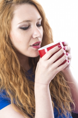 model released: Model Released. Attractive Young Woman Drinking Tea Stock Photo