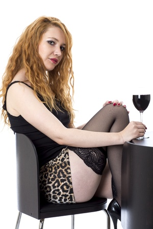 Model Released. Sexy Young Woman Drinking Red Wine