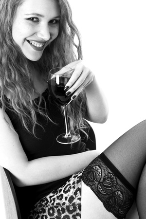 Model Released. Sexy Young Woman Drinking Red Wine photo