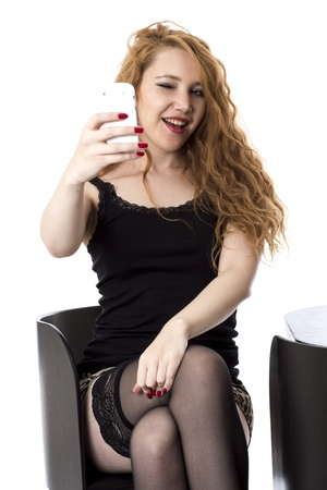selfy: Model Released. Young Woman Using Mobile Telephone