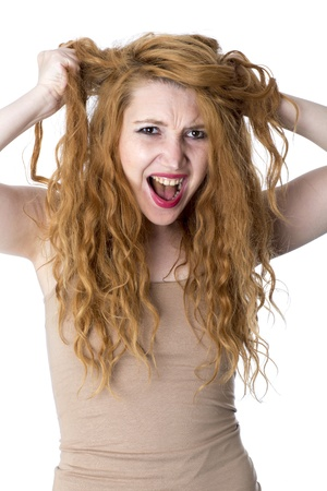 Model freigegeben. Angry Young Woman Tearing Haar Out