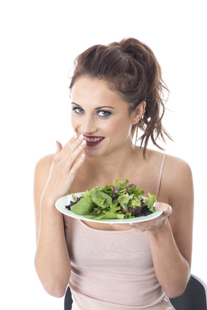 leafed: Model Released. Attractive Young Woman Eating Green Leafed Salad Stock Photo