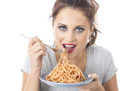 Model Released. Attractive Young Woman Eating Spaghetti