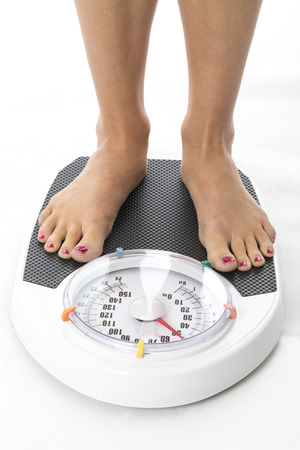 bathroom scale: Model Released. Attractive Young Woman on Bathroom Scales