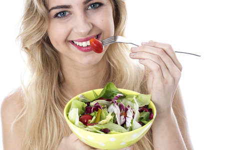 Attractive Happy Young Woman Eating Salad Stock Photo - 22273013