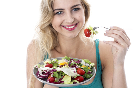 Attractive Happy Young Woman Eating Salad Stock Photo - 22273015