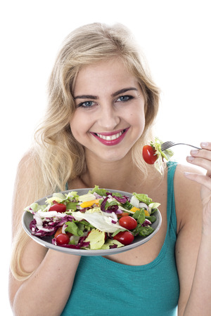 Attractive Happy Young Woman Eating Salad Stock Photo - 22273011
