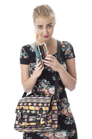 Woman Wearing a Short Tight Mini Dress looking in Empty Purse photo