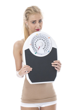 Attractive Young Woman with Bathroom Scales Stock Photo - 22301080