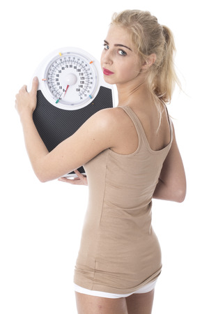 Model Released. Attractive Young Woman with Bathroom Scales Stock Photo - 22301089