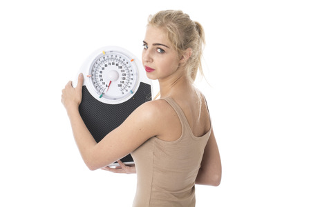 Model Released. Attractive Young Woman with Bathroom Scales Stock Photo - 22301091