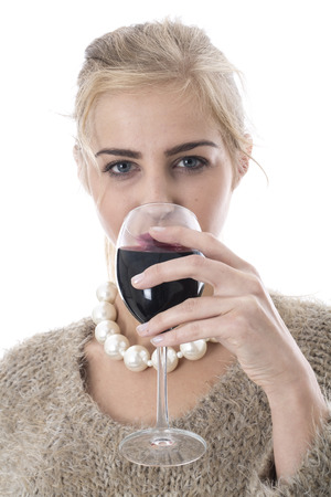 Young Woman Drinking a Glass of Red Wine photo