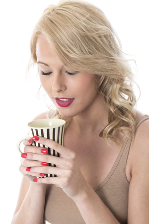 Model Released. Attractive Young Woman Drinking Coffee Stock Photo - 22337582