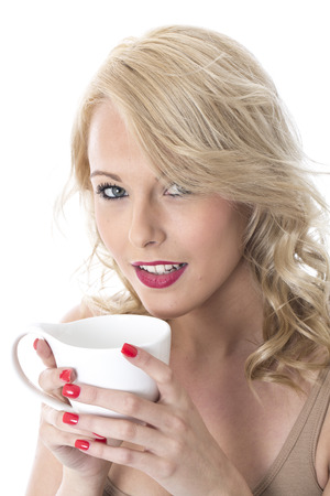 Model Released. Attractive Young Woman Drinking Coffee Stock Photo - 22337584