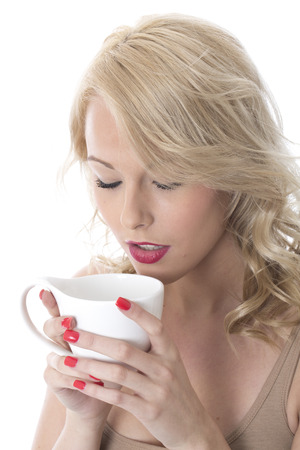 Model Released. Attractive Young Woman Drinking Coffee Stock Photo - 22337585