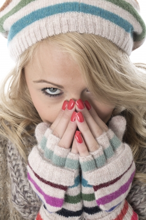 Model Released. Cold Young Woman Wearing a Wooly Hat and Gloves Stock Photo - 22337797