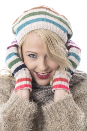 Model Released. Cold Young Woman Wearing a Wooly Hat and Gloves Stock Photo - 22337807