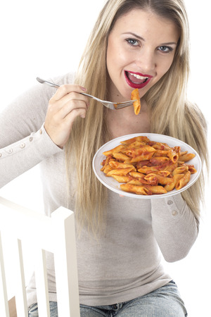 Attractive Young Woman Eating Penne Pasta photo