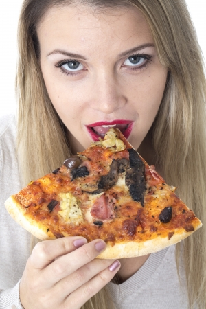 Attractive Young Woman Eating Pizza photo