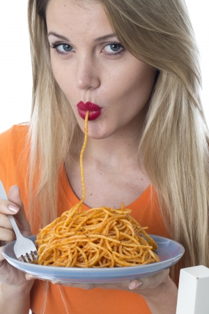 Attractive Young Woman Eating Spaghetti Pasta photo
