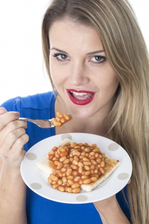 baked beans:  Attractive Young Woman Eating Baked Beans on Toast Stock Photo