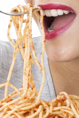 Model Released. Attractive Young Woman Eating Spaghetti photo