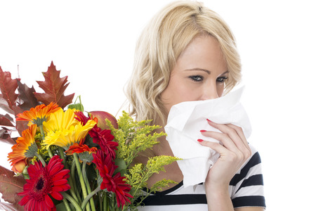 hayfever: Model Released. Attractive Young Woman with Hayfever Holding a Bunch of Flowers