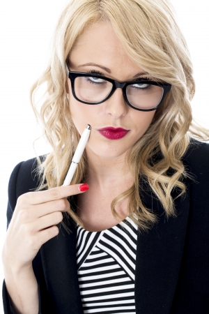 Model Released. Thoughtful Young Business Woman Wearing Glasses photo
