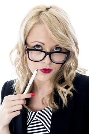 cropped out: Model Released. Thoughtful Young Business Woman Wearing Glasses Stock Photo