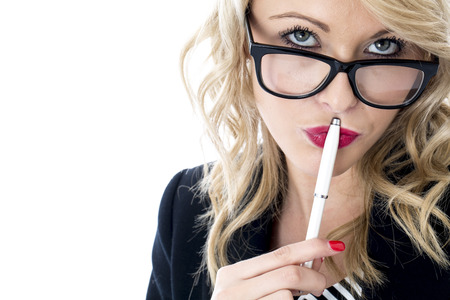 model released: Model Released. Thoughtful Young Business Woman Wearing Glasses Stock Photo