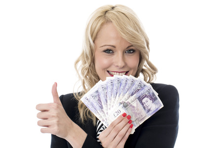 Model Released. Attractive Young Woman Holding Money photo