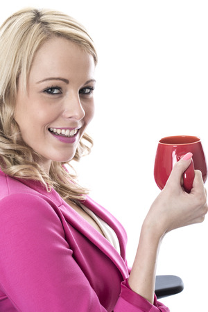 elevenses: Model Released. Attractive Young Business Woman Drinking a Mug of Tea