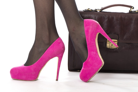 pink posing: Model Released. Attractive Young Woman Pink High Heels and Briefcase Stock Photo