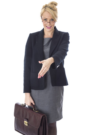 shaking out: Model Released. Young Business Woman Carrying Briefcase Shaking Hands