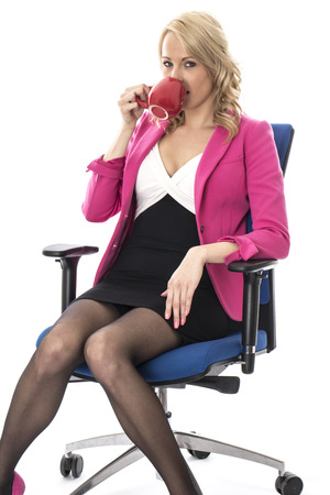 elevenses: Model Released. Attractive Young Business Woman Drinking Coffee Stock Photo