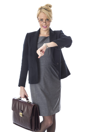 cut wrist: Model Released. Young Business Woman Holding a Briefcase Looking at Watch