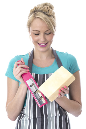 grating: Model Released  Attractive Young Woman Grating Cheese Stock Photo