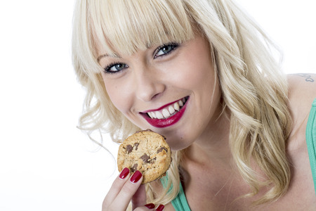 Young Woman Eating a Chocolate Chip Cookie Biscuit photo