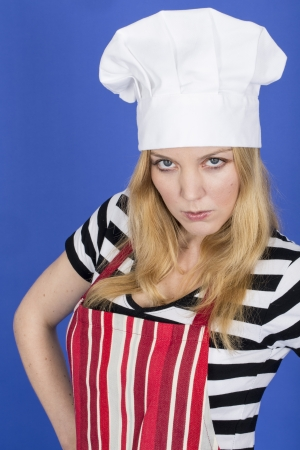 Model Released. Angry Young Woman in Chefs Hat and Apron Stock Photo - 22909921