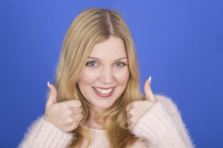 Model Released. Attractive Young Woman Thumbs Up Sign Stock Photo - 22910076
