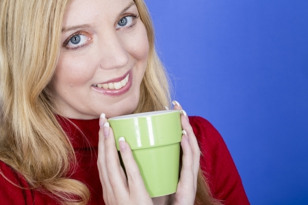 elevenses: Model Released. Attractive Young Woman Holding Cup Coffee Stock Photo
