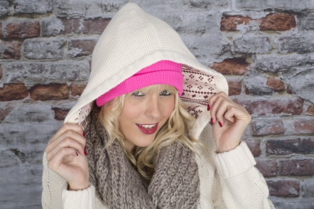 hair wrapped up: Model Released. Happy Young Woman Wearing a Hooded Coat