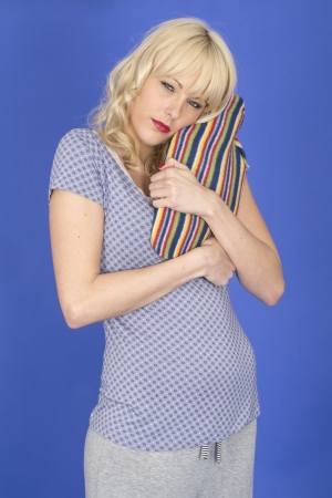 warm water: Model Released. Attractive Young Woman Holding a Hot Water Bottle