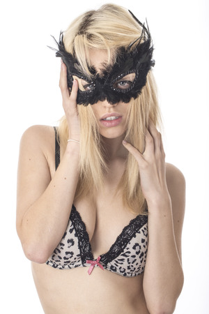 concealing: Model Released. Sexy Young Woman Modeling Lingerie in a Mask Stock Photo