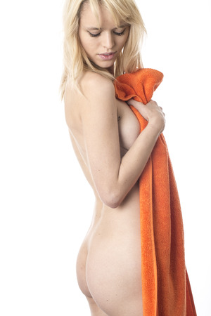 Model Released. Naked Young Woman Holding a Towel photo